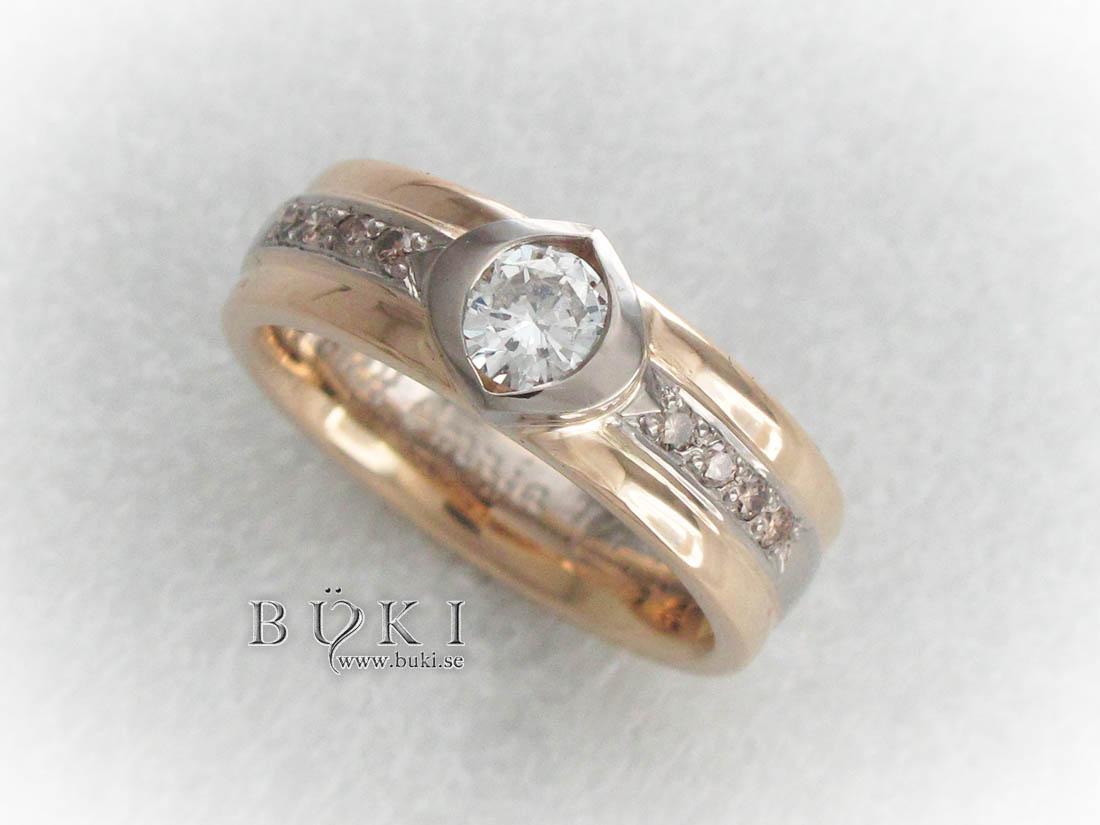 alliansring-i18k-vitguld-o-rödguld-med-coffe-diamanter-och-vit-diamant-infattad-som-öga