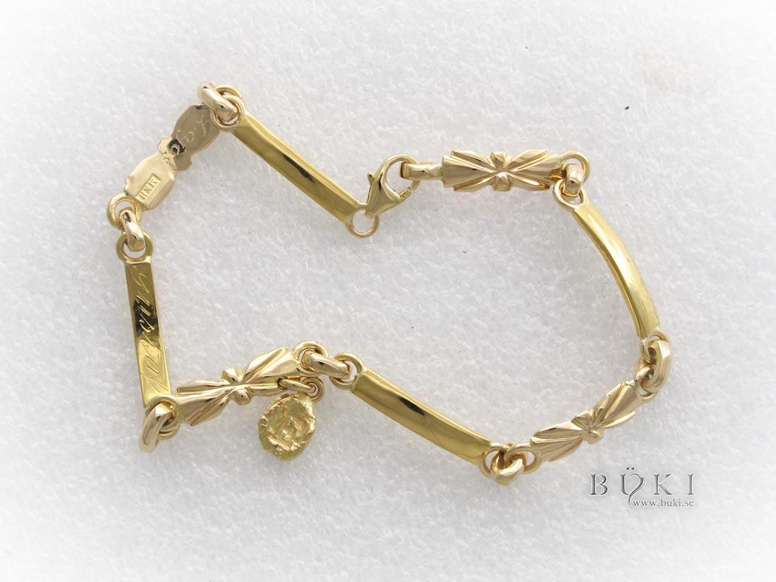 armband-i-18k-guld-gjort-av-gamla-släta-ringar