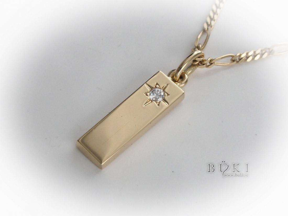 guldtacka-18k-med-diamant