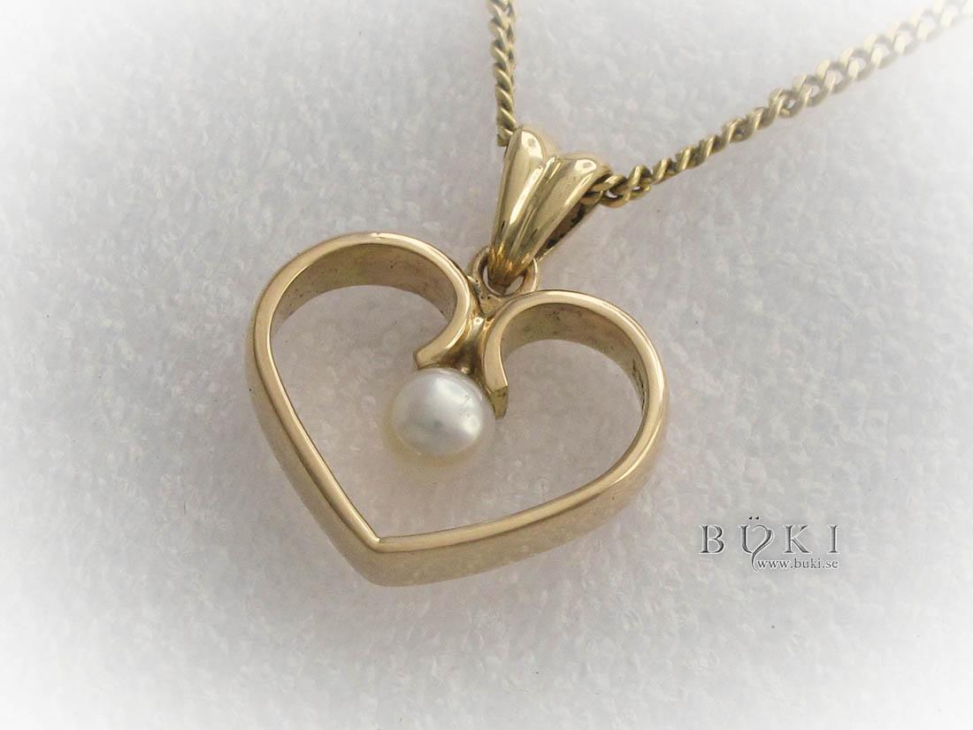 ängsmycke-18k-guld-hjärta-med-pärla-omarbetning-från-slät-ring