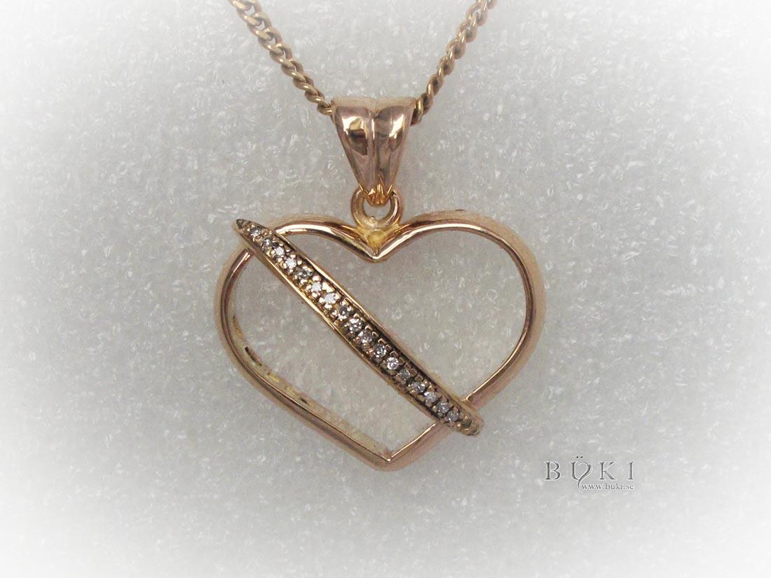 hängsmycke-i-18k-guld-och-diamanter.-omarbetning-från-slät-ring-och-alliansring