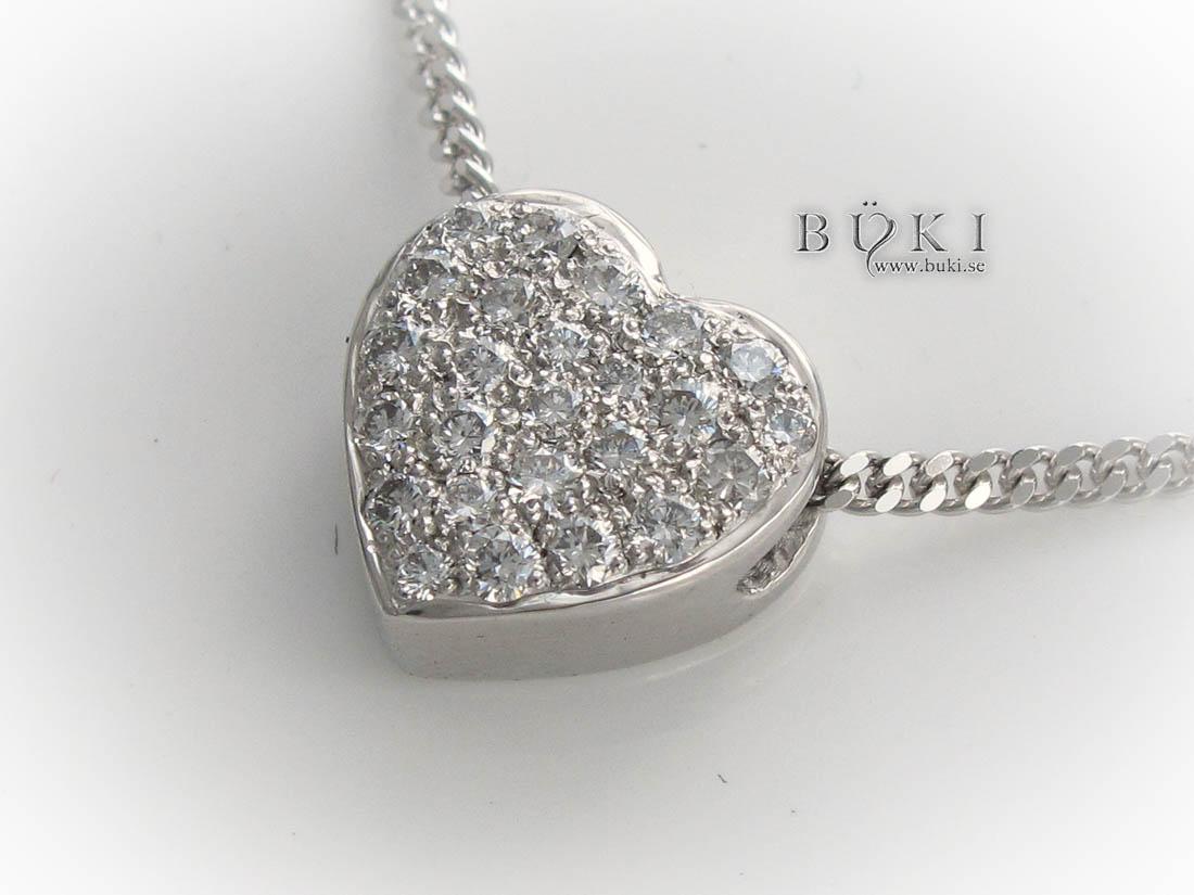 hjärta-i-18-k-vitguld-med-diamanter-från-gammal-alliansring